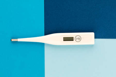 Digital medical thermometer. On a blue background