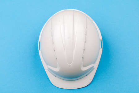 White engineering helmet on a blue background. The view from the top.