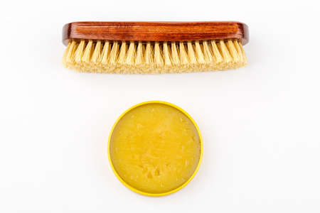 Shoe brush and shoe cream jar are isolated on a white background Stock Photo