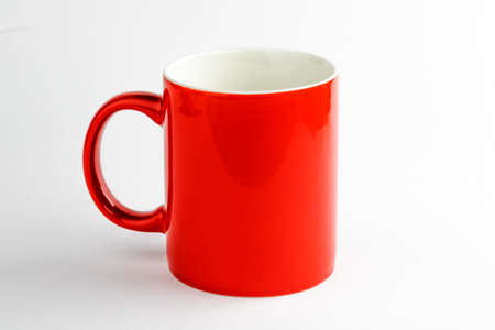 Red ceramic cup on white background