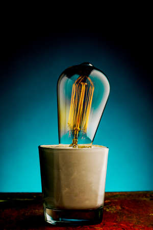 Retro lamp with an Edison lamp on a blue background.