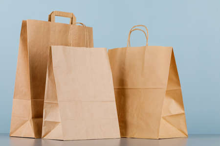 Brown paper bag with handles, empty shopping bag with area for your logo or design, food delivery concept