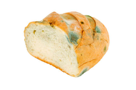 Moldy bread on a white background. Expired pastries.