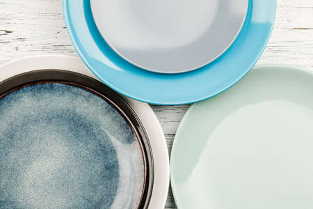 A set of clean dishes and cups. Handmade ceramics, catering, restaurant, healthy food. Space for text.