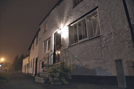 english house: View on an entrance area of english house at night. Tarvin, Cheshire, UK