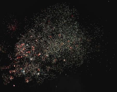 Shiny natural fireworks on dark sky background with little smoke Archivio Fotografico