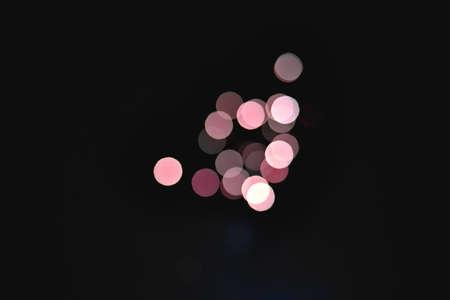 Light blur and defocus bokeh circles on black sky background Archivio Fotografico