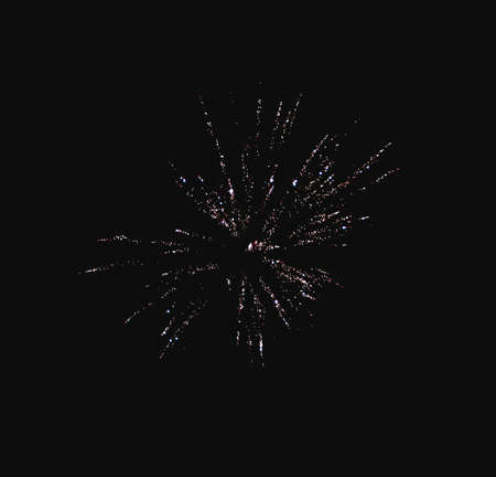 Shiny natural fireworks on dark sky background with little smoke Standard-Bild
