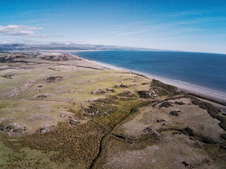 Aerial view, Drone panorama over meadow, sheep and sea in Wales