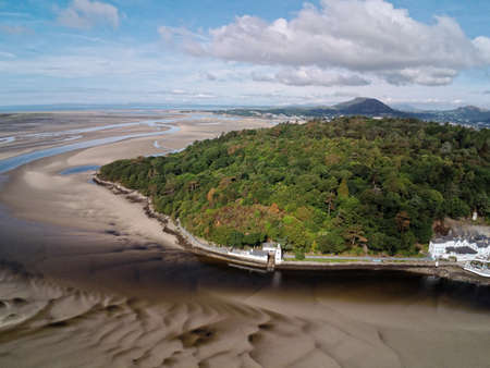 Aerial view, Drone panorama of lighthouse on cape in Portmeirion, Snowdonia mountains in Wales Standard-Bild