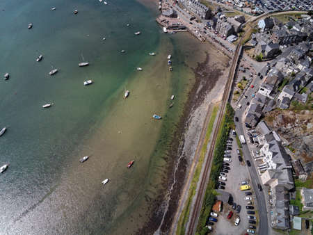 Aerial view, Drone top down panorama over buildings, railway line, road, beach and old town of Barmouth, Wales Standard-Bild