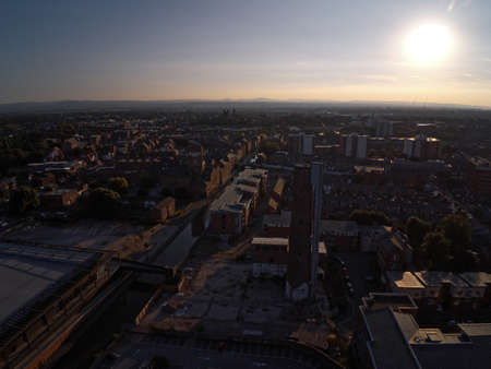 Aerial view, drone silhouette of Chester city during sunset sun close to canal, old shot tower and steam mill area Standard-Bild
