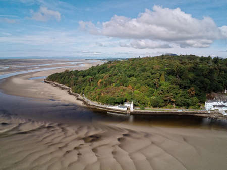 Aerial view, Drone panorama of lighthouse during low tide on cape in Portmeirion, Snowdonia mountains in Wales Standard-Bild