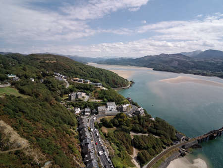 Aerial view, Drone panorama over sea, tree, hills and houses, Barmouth, Wales
