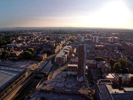 Aerial view, drone panorama of Chester city during sunset sun close to canal, old shot tower and steam mill area