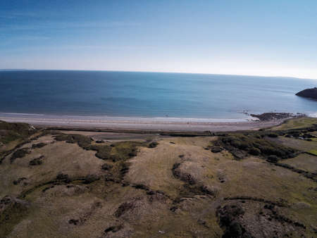 Aerial view, Drone panorama over meadow, shore and sea in Wales