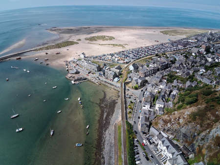 Aerial view, Drone panorama over sea, harbor, beach and old town of Barmouth, Wales
