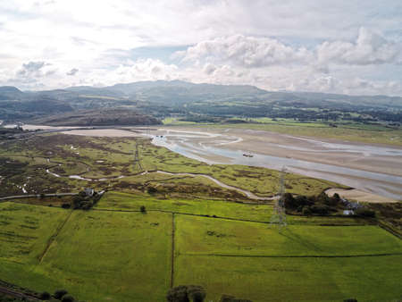 Aerial view, Drone panorama of sea bay during low tide in hilly Wales