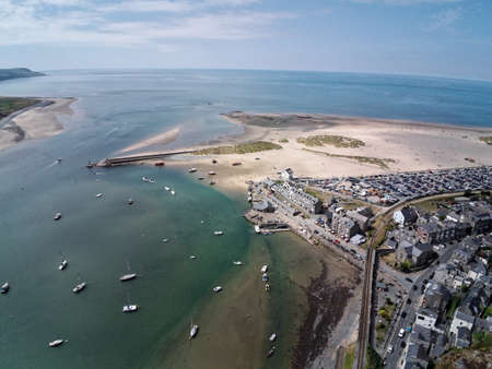 Aerial view, Drone panorama over sea, harbor, beach and old city of Barmouth, Wales