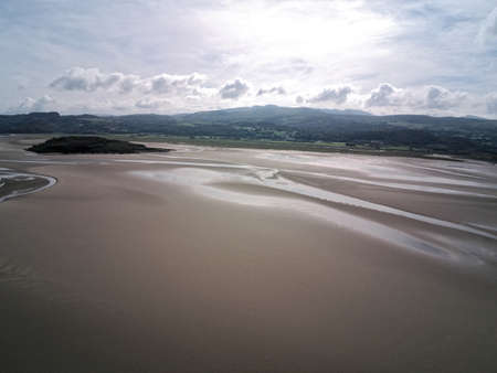 Aerial view, Drone panorama of Grifftan island on low tide sea in Snowdonia mountains in Wales Standard-Bild