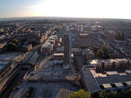 Aerial view, drone panorama of Chester city during golden hour sun close to canal, old shot tower and steam mill area