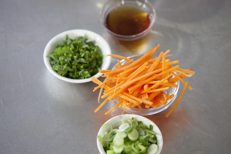 julienne: Julienne cut carrot and other spring roll ingredients on a kitchen counter