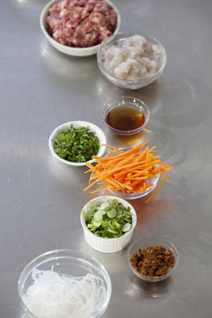 julienne: Julienne cut carrot and other stir-fry ingredients on a kitchen counter