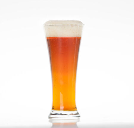 squire: Amber ale beer in a glass on a white background