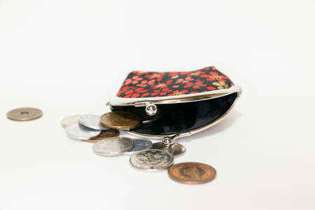 coin purses: wallet and coins on white background Stock Photo