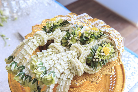 Thai garland flowers on gold tray with pedestal Stock Photo