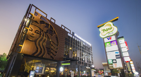 BANGKOK, THAILAND - February 27, 2015 :Grand opening Starbucks Drivethru new branch at The Paseo Park New Japanese village-style community mall  at Kanchanapisek Road on February 27, 2015  in Bangkok , Thailand.