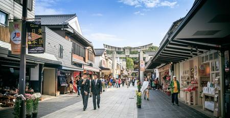 FUKUOKA, KYUSHU, JAPAN- November 12, 2015: Fukuoka on November 12, 2015. Tourists are traveling in the shopping street of Dazaifu shrine. Editorial