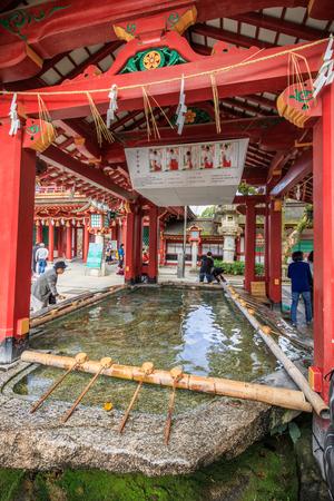 DAZAIFU, JAPAN - November 12,2015: Beautiful Picture of Japanese Purification water in Dazaifu Shrine. Ladle For Water Used To Wash Faces at Dazaifu Shrine on Nov 12,2015 in Fukuoka, japan