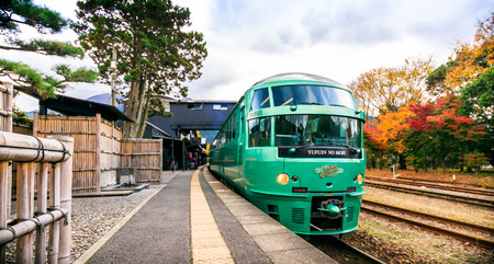 Yufuin, Japan - November 11, 2015:Yufuin train station on November 11, 2015 in Yufuin, Japan.The Yufuin No Mori Train (meaning Forest of Yufuin) is the famous and signature train for travellers to go to Yufuin city.