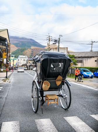 Yufuin, Japan - November 11, 2015:Japanese rickshaw or old style two wheeled passenger cart on November 11, 2015 in Oita, Japan.