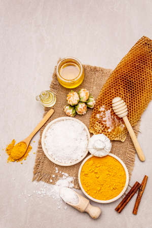 Personal care with natural ingredients. Healthy spa concept. Turmeric, sea salt, honey, cinnamon, oil. Stone concrete background, copy space, top view