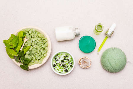 Healthy self-care. Minimalistic organic lifestyle. Comfort and natural pharmacy. Sea salt, herbal oil, dry and fresh leaves. Bowls, stone concrete background, copy space, top view, close up