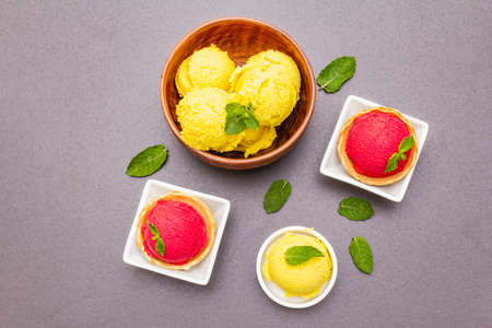 Assorted of beet and tomato ice cream, sorbet, gelato, mint. Summer healthy refreshment dessert. Vegetarian (vegan) trendy food concept. Stone concrete background, copy space, top view