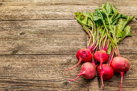 Fresh organic ripe beetroot. Autumn harvest vegetables. Preparation healthy food concept. Old vintage wooden boards background, copy space Stockfoto