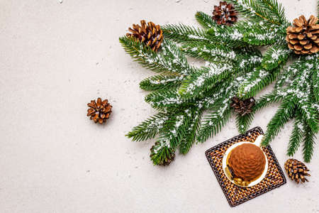 Festive dessert in the shape of a Christmas fir cone. New Year sweet treat concept. Stone concrete background, copy space, top view