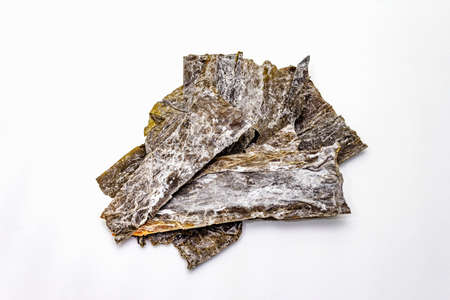 Dry laminaria japonica(kelp)Isolated on white background. Kombu seaweed, traditional Japanese ingredient for cooking Dashi soup, copy space