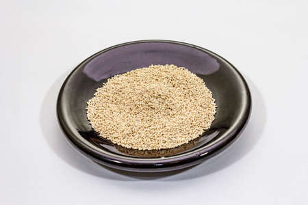 Dashi, traditional Japanese seasoning isolated on white background. Indispensable ingredient for cooking soup stock. Finished dry granules, close up