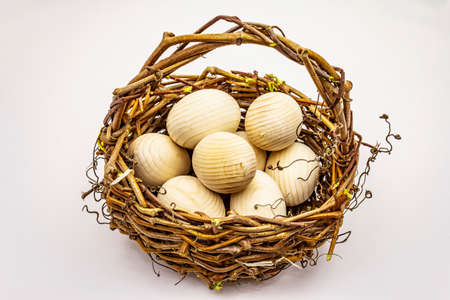 Easter wicker basket isolated on white background. Zero waste, DIY concept. Wooden eggs Stockfoto