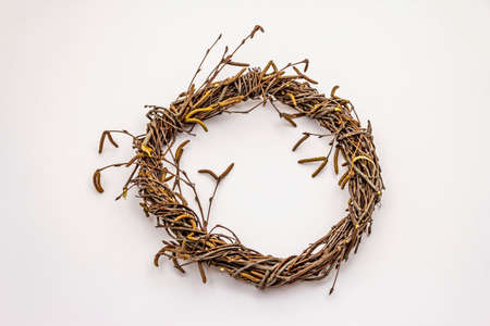 Wicker wreath of birch branches isolated on white background. Easter zero waste, DIY concept. Design element and decor
