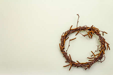 Wicker wreath of birch branches. Easter zero waste, DIY concept. Design element and decor. Light background, copy space, top view