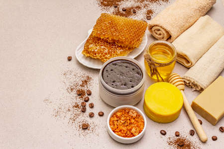 Spa concept. Self care with honey, coffee and turmeric. Natural organic cosmetics, homemade product, alternative lifestyle. White putty background