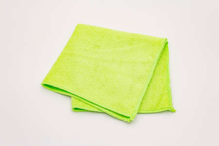 Green duster isolated on white background. House cleaning product, home disinfection in quarantine