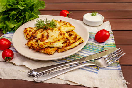 Hot appetizer - pita bread with cheese and herbs. Vegetarian healthy food. Wood table background, close up