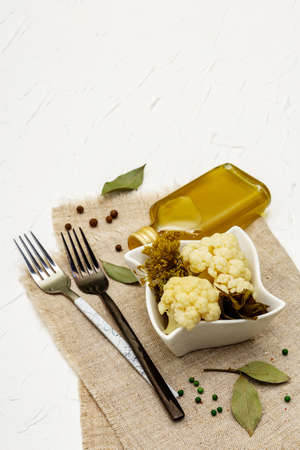 Homemade sauerkraut village fermented cauliflower. Vegan salad rustic style in ceramic bowl. Fermented food great for good health. Traditional rustic winter food. Probiotics food concept, copy space