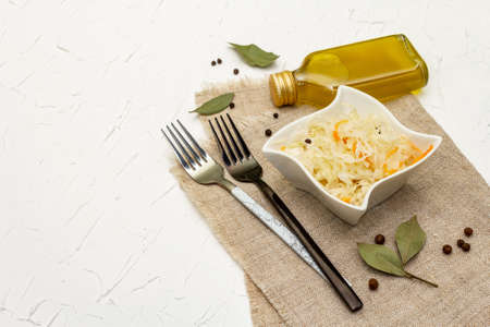 Homemade sauerkraut village fermented cabbage. Vegan salad rustic style in ceramic bowl. Fermented food great for good health. Traditional rustic winter food. Probiotics food concept, copy space Stock Photo